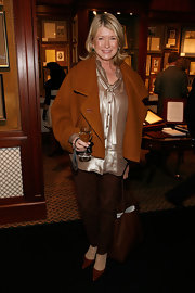 Martha Stewart looked glam in a cropped rust coat and silky tie-neck blouse.