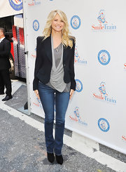 Christie gave her drapey top and blue jeans a touch of sophistication with a feminine-fitting blazer.