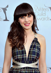 Zooey Deschanel wore her long hair in tousled waves with heavy lash-grazing bangs at the 2012 Writers Guild Awards.