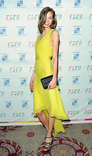 Karlie Kloss tempered her neon dress with a sleek black satin clutch.