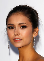 Nina Dobrev drew her hair back into a sleek elegant bun for the amfAR Cinema Against AIDS event.
