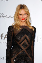 Natasha Poly wore her glossy blond locks in stylishly mussed layers while attending the amfAR Cinema Again AIDS event.