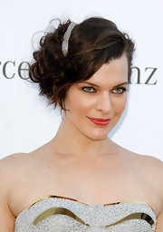 Milla Jovovich styled her hair in a pretty mass of messy curls accented with a sparkly silver barrette.