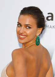 Irina Shayk wore her hair in an ultra-casual updo set off by luminous skin and minimal makeup.