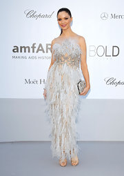 Forever a promoter of her own art, Georgina Chapman wore one of her feathery designs to the amfAR benefit.