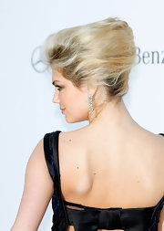 Kate Upton wore her hair swept into a voluminous textured French twist at the amfAR Gala.