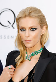 Anja Rubik wore an emerald and white diamond collar necklace and ring at the amfAR Gala.