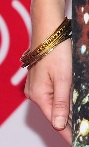Candice Accola kept the bling to a minimum with a few gold bangles when she attended the 2012 iHeartRadio Music Festival.