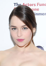 Emilia Clarke opted for a matte pink lipstick in a fun cotton candy color for her beauty look at the Actors Fund Gala.
