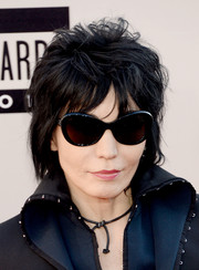 Joan Jett stuck to her usual edgy layered razor cut when she attended the American Music Awards.