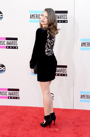 Maia Mitchell went for subtle sexiness at the American Music Awards in an Armani LBD with an embellished back.