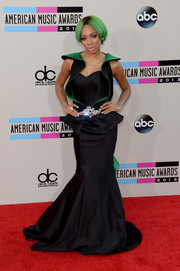 Lil Mama's black and green mermaid gown at the American Music Awards was glamorous with a futuristic feel.