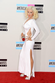 Christina Aguilera looked quite the bombshell in a sultry white cutout dress by Maria Lucia Hohan during the American Music Awards.