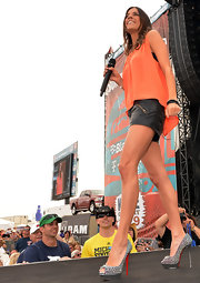 Jana Kramer completed her performance look at the 2013 Arizona County Thunder Music Festival with a pair of Christian Louboutin peep toe studded heels.