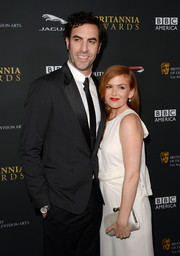 Isla Fisher went all white at the BAFTA LA Britannia Awards with this satin clutch and evening dress combo.
