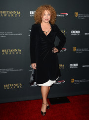 Alex Kingston looked very stylish in a black wrap dress during the BAFTA LA Britannia Awards.