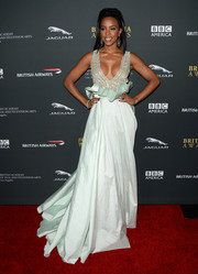 Kelly Rowland was dressed to impress in a cleavage-baring baby-blue Rani Zakhem gown with a voluminous skirt and waist ruffles during the BAFTA LA Britannia Awards.