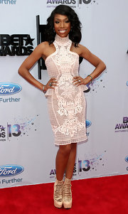 Brandy rocked a beaded, sheer lace dress that featured a high neck and peplum at the waist.