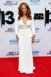 Beverly Johnson chose a long-sleeve white dress with a silver belt and plunging neckline for her look at the 2013 BET Awards.