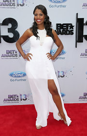 Omarosa showed a peek of leg with this white halter neck fishtail dress.