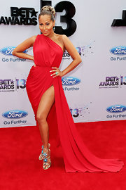 Adrienna Bailon showed her sexy side with this red one-shoulder dress that had a slit that stretched up to her thigh.