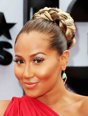 Adrienne Bailon showed off her brown and blonde tresses with a high, braided bun.