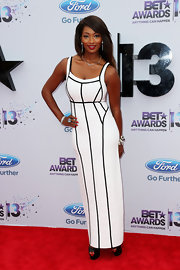 Toccara showed off her figure in this white dress with black piping.