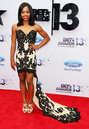 Gabrielle Douglas opted for an elegant cream and black lace fishtail dress for the 2013 BET Awards.