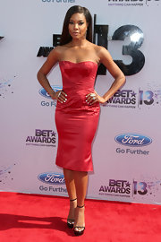 Gabrielle Union showed off her curves in this fitted strapless, red cocktail dress.