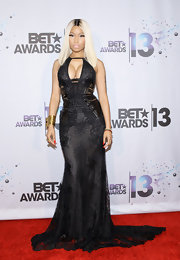 Nicki showed off some major curves in this black fitted dress that featured a flowing train and a cutout at the bust.