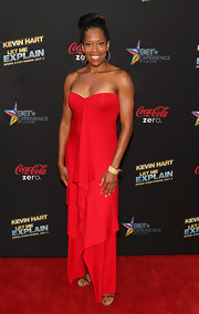 Regina King rocked a bold red strapless dress that featured a front ruffle detail.