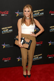 Cassie chose a cream V-neck crop top to pair with her tapered pants at the 'Let Me Explain' movie premiere.