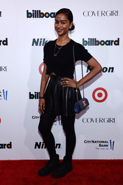A quilted blue Chanel bag broke Vashtie Kola's all-black theme.