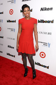 Tamron Hall kept it simple in a red dress with cap sleeves and a fit-and-flare silhouette when she attended the Billboard Women in Music event.