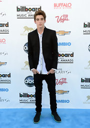 To balance out his structured blazer, Jackson Guthy opted for a pair of skinny black jeans.
