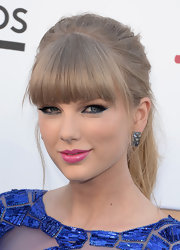 Taylor jumped on the pink lipstick trend at the Billboard Music Awards where she donned this hot pink color.