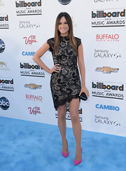 Kacey's black lace dress with an asymmetrical hem had a flirty romantic look to it at the 2013 Billboard Music Awards.