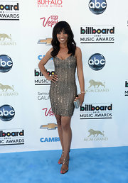 Shaun Robinson chose a silver beaded frock to add some sparkle to her look at the 2013 Billboard Music Awards.