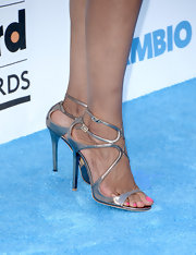 Shaun Robinson chose a pair of silver strappy sandals for her sleek and shiny look at the Billboard Music Awards.