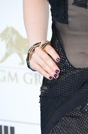 Carly Rae Jepsen's purple nails added a fun touch of color to her blue carpet look at the 2013 Billboard Music Awards.