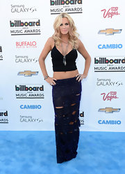 Jenny McCarthy topped off her blue carpet look with this sparkly navy tattered maxi skirt.