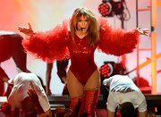 Jennifer Lopez looked totally fierce on stage when she wore this red bodysuit that featured feathered sleeves.