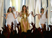 Selena shimmered in a gold metal bodysuit that featured gold fabric draping on the sides.