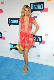 Brandi Glanville's lace frock showed off her awesome figure with it's deep scalloped neck and cinched waist.