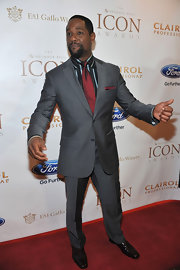 Blair Underwood's cranberry tie stood out against his stripped button-down and silver suit at the ICON Awards.