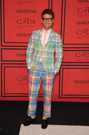 Brad Goreski showed off his fun and quirky style with this multi-colored plaid suit.