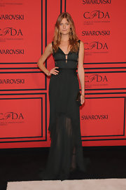 Constance Jablonski showed off her long and lean frame with this sleeveless black gown that featured a tiered ruffle detailed skirt.