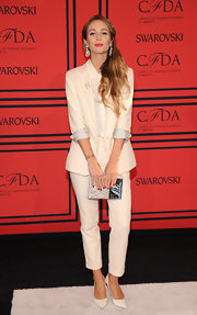Harley Viera-Newton wore this masculine-inspired off-white pantsuit to the 2013 CFDA Fashion Awards.