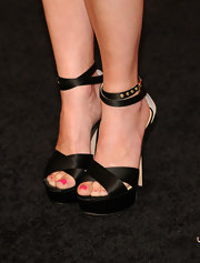 Linda Cardellini paired these black satin platform sandals with her leather dress for a super cool monochromatic look.