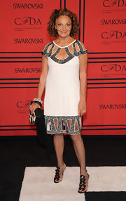 Diane von Furstenberg chose a loose-fitting white frock with silver embellished cutouts at the neck and hem for her cool Art Deco-inspired look.